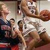 North Middlesex Regional High School boys basketball visited Fitchburg High School on Friday night, Jan. 3, 2020. FHS's #2 Donovan Deleon drives to the basket. SENTINEL & ENTERPRISE/JOHN LOVE