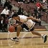 North Middlesex Regional High School boys basketball visited Fitchburg High School on Friday night, Jan. 3, 2020. FHS's #1 Esteve Dias gets control of a loose ball. SENTINEL & ENTERPRISE/JOHN LOVE