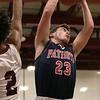 North Middlesex Regional High School boys basketball visited Fitchburg High School on Friday night, Jan. 3, 2020. NM's #23 Ryan McGrath gets a rebound. Next to him is FHS's #2 Donovan Deleon. SENTINEL & ENTERPRISE/JOHN LOVE