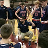 North Middlesex Regional High School boys basketball visited Fitchburg High School on Friday night, Jan. 3, 2020. NM's Head Coach Jon doherty talks to his team during a timeout. SENTINEL & ENTERPRISE/JOHN LOVE