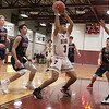 North Middlesex Regional High School boys basketball visited Fitchburg High School on Friday night, Jan. 3, 2020. FHS's #3 Jorge Gaitan looks for a teammate to pass to after getting a rebound while surrounded by NM players. SENTINEL & ENTERPRISE/JOHN LOVE
