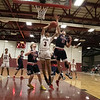 North Middlesex Regional High School boys basketball visited Fitchburg High School on Friday night, Jan. 3, 2020. NM's #23 Ryan McGrath tries to stop a shot by FHS's #3 Jorge Gaitan. SENTINEL & ENTERPRISE/JOHN LOVE