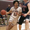 North Middlesex Regional High School boys basketball visited Fitchburg High School on Friday night, Jan. 3, 2020. FHS's #11 Juilo Torres drive by NM's #33 Will McCarthy. SENTINEL & ENTERPRISE/JOHN LOVE