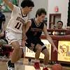 North Middlesex Regional High School boys basketball visited Fitchburg High School on Friday night, Jan. 3, 2020. FHS's #11 Juilo Torres covers NM's #2 Alban Badoci. SENTINEL & ENTERPRISE/JOHN LOVE