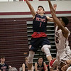 North Middlesex Regional High School boys basketball visited Fitchburg High School on Friday night, Jan. 3, 2020. NM's #1 Jake Richard leaps for a shot. SENTINEL & ENTERPRISE/JOHN LOVE