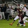 Fitchburg High School football played North Middlesex Regional High School on Friday night in Fitchburg. NMRHS's #12 Josh LeBlanc runs into FHS's #3 Latrell Boddie. SENTINEL & ENTERPRISE/JOHN LOVE