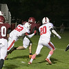 Fitchburg High School football played North Middlesex Regional High School on Friday night in Fitchburg. FHS's #7 Anthony Oquendo carries NMRHS's #52 Jared Woods into the end zone. SENTINEL & ENTERPRISE/JOHN LOVE