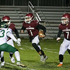 Fitchburg High School Played Nashoba Regional High School on Friday night in Fitchburg during the Central Mass. Division 4 semifinals. FHS's #1 Montgomery Graham, #7 Anthony Oquendo and NRHS's #33 Ethan Revell. SENTINEL & ENTERPRISE/JOHN LOVE