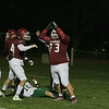 Fitchburg High School Played Nashoba Regional High School on Friday night in Fitchburg during the Central Mass. Division 4 semifinals. FHS's #73 Sam Faulkner celebrates stopping NEHS's #15 Trevor Schartner on the one yard line. SENTINEL & ENTERPRISE/JOHN LOVE