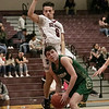 Fitchburg High School boys basketball played Nashoba Regional High School on Tuesday, Jan. 14, 2020. FHS's #0 Gabriel Rivera tries to stop a shot by NRHS's #11 Mitch Scanlon. SENTINEL & ETERPRISE/JOHN LOVE