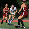 Nashoba Regional High School field hockey played Fitchburg High School Wednesday, September 26, 2018. NRHS player Chloe Spedden takes control of the ball. Just behind her is FHS's Olivia Tran. SENTINEL & ENTERPRISE/JOHN LOVE