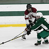 Fiutchburg High School/Monty Tech hockey played Oakmont Regional High school on Thursday afternoon, Feb. 13, 2020 at the Wallace Civic Center at Fitchburg State University in Fitchburg. FHS's #3 ryan Johnson fights for control of the puck with ORHS's #6 Blake Riggins. SENTINEL & ENTERPRISE/JOHN LOVE