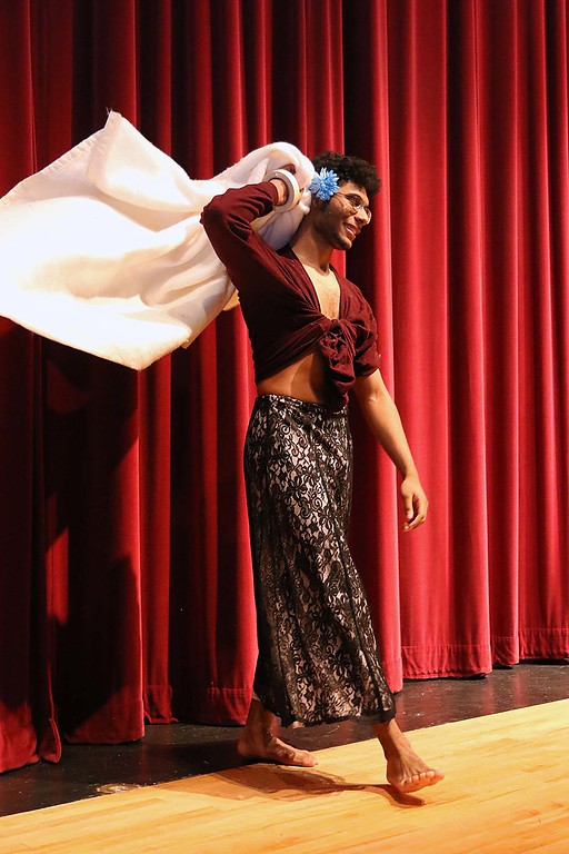 """. Fitchburg High School held its \""""Mr. Fitchburg\"""" competition on Thursday night in the school\'s auditorium. Parading on stage in a dress was senior Gio Soto during the competition. SENTINEL & ENTERPRISE/JOHN LOVE"""