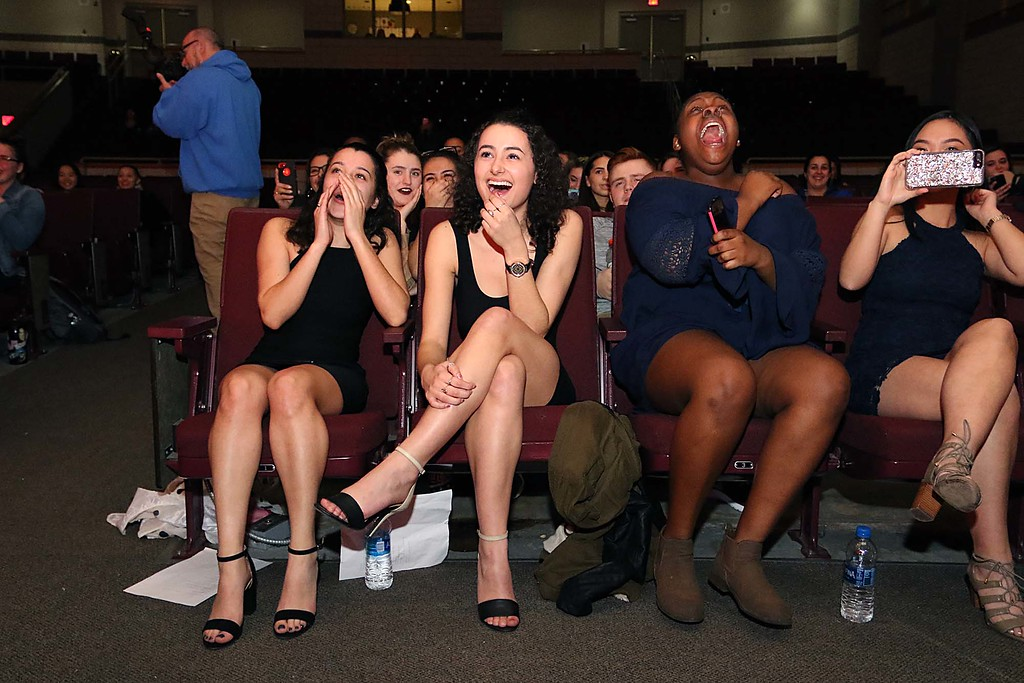 """. Fitchburg High School held its \""""Mr. Fitchburg\"""" competition on Thursday night in the school\'s auditorium. Enjoying the show was, from left, seniors Jazmyne Rodriguez, Michelle Cochran and Nyejah Johnson. SENTINEL & ENTERPRISE/JOHN LOVE"""
