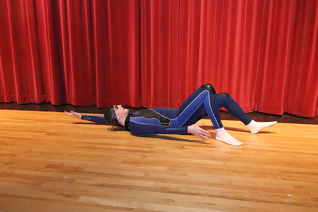 """. Fitchburg High School held its \""""Mr. Fitchburg\"""" competition on Thursday night in the school\'s auditorium. Showing off his backstroke on stage during the comeptition is senior Sage Bray. SENTINEL & ENTERPRISE/JOHN LOVE"""