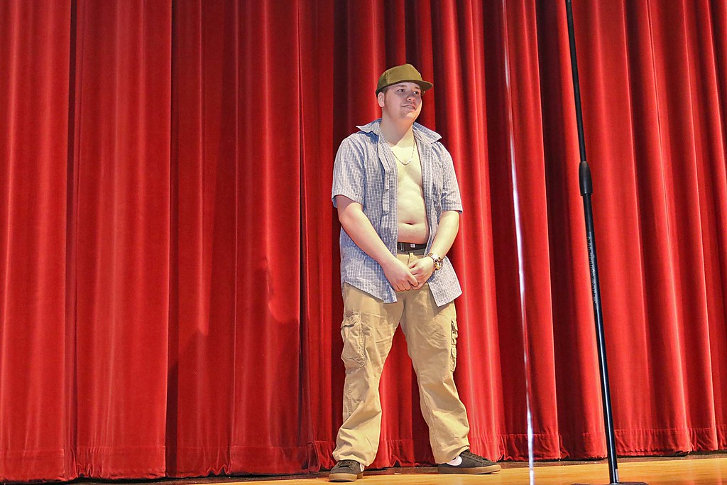 """. Fitchburg High School held its \""""Mr. Fitchburg\"""" competition on Thursday night in the school\'s auditorium. Senior Dennis Tardif shows off his stuff on stage during the competition. SENTINEL & ENTERPRISE/JOHN LOVE"""