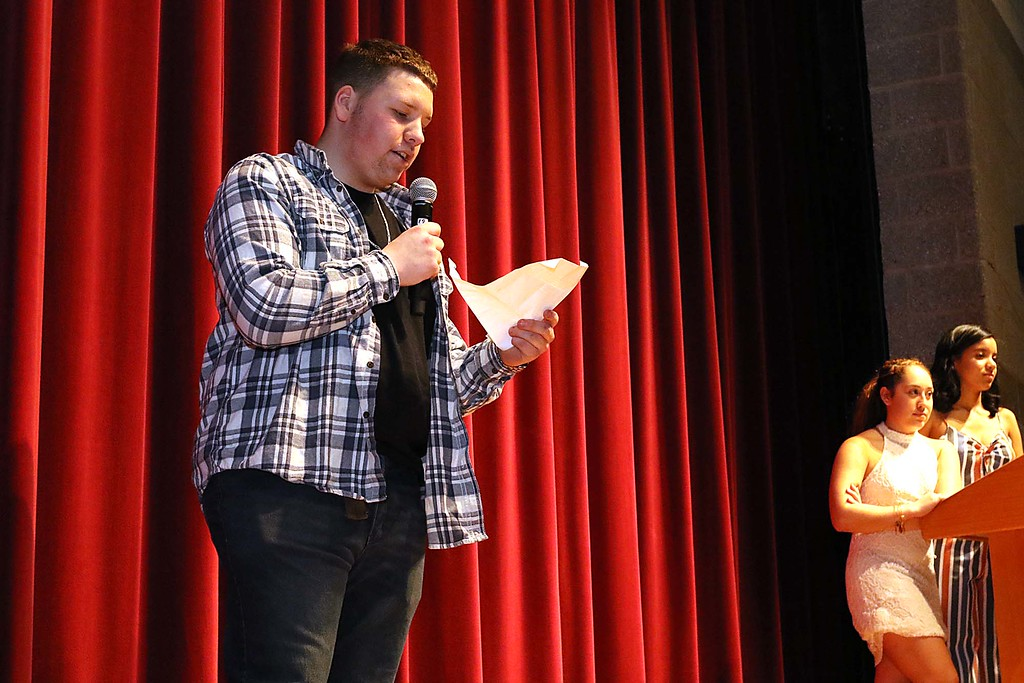 """. Fitchburg High School held its \""""Mr. Fitchburg\"""" competition on Thursday night in the school\'s auditorium. Playing it simple and sweet by reading a poem during the competition was senior Dennis Tardif. SENTINEL & ENTERPRISE/JOHN LOVE"""