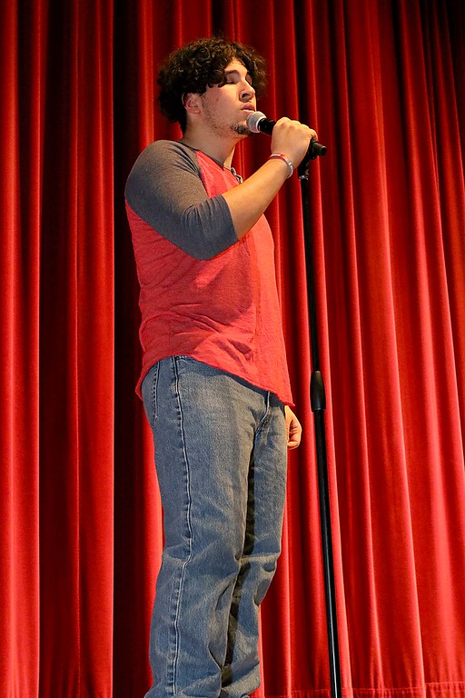 """. Fitchburg High School held its \""""Mr. Fitchburg\"""" competition on Thursday night in the school\'s auditorium. Showing off his singing skills during the competition was Rico Colon. SENTINEL & ENTERPRISE/JOHN LOVE"""