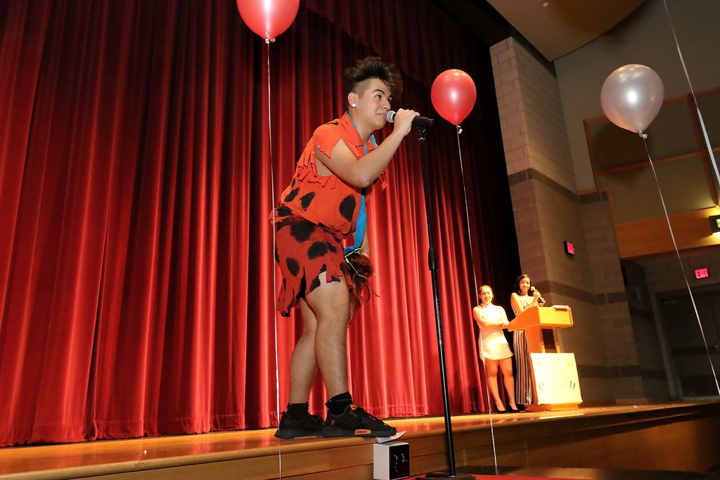 """. Fitchburg High School held its \""""Mr. Fitchburg\"""" competition on Thursday night in the school\'s auditorium. Dressed like Fred Flintstone and singing for the crowd was senior Yoen Pedraza. SENTINEL & ENTERPRISE/JOHN LOVE"""