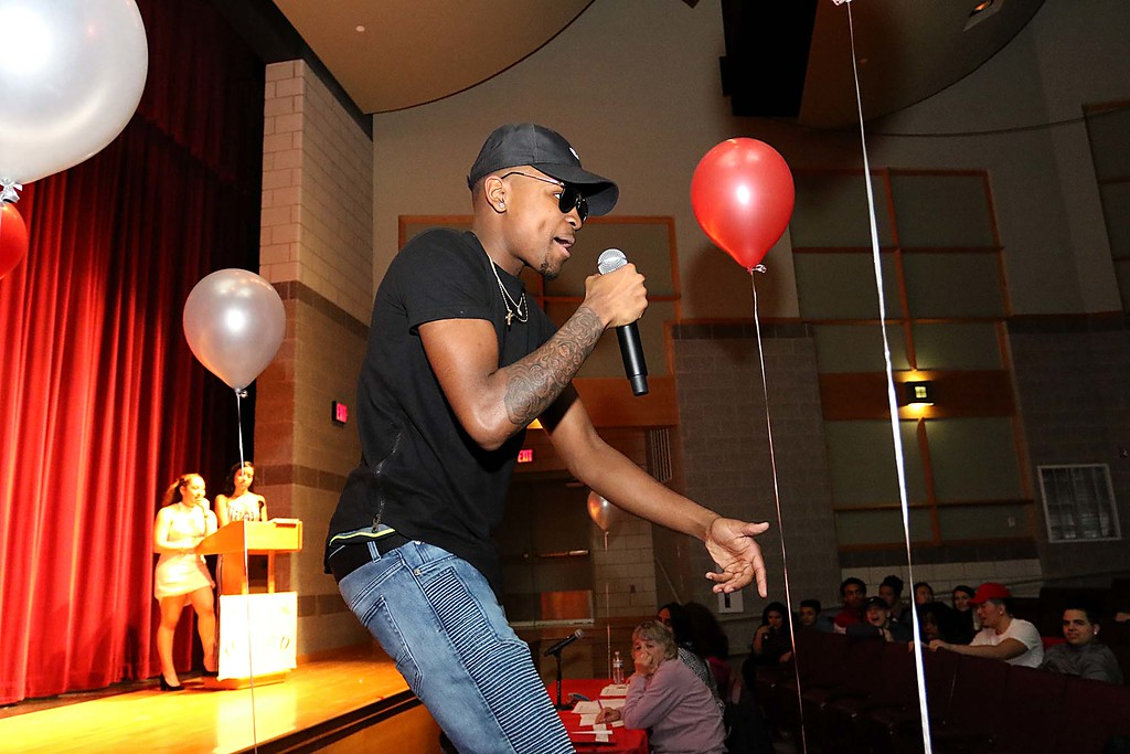 """. Fitchburg High School held its \""""Mr. Fitchburg\"""" competition on Thursday night in the school\'s auditorium. Singing a rap during the competition was senior Davonte Johnson. SENTINEL & ENTERPRISE/JOHN LOVE"""