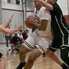 Fitchburg High School boys basketball played Marlborogh High School on Thursday night, Jan 30, 2020 in Fitchburg. FHS's #25 Kenny Marte is guarded by MHS's #10 Jayce Ginnetti as he drives to the basket. SENTINEL & ENTERPRISE/JOHN LOVE