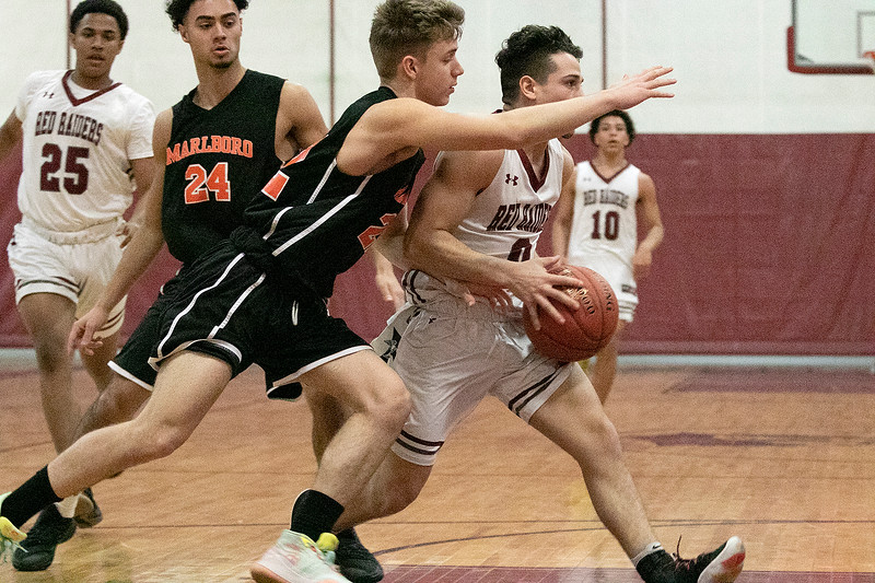 Fitchburg High School boys basketball played Marlborogh High School on Thursday night, Jan 30, 2020 in Fitchburg. FHS's #0 Gabriel Rivera is guarded by MHS's #22 Ryan Dudek. SENTINEL & ENTERPRISE/JOHN LOVE