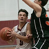 Fitchburg High School boys basketball played Marlborogh High School on Thursday night, Jan 30, 2020 in Fitchburg. FHS's #0 Gabriel Rivera is guarded by MHS's #32 Jason Short as he drives to the basket. SENTINEL & ENTERPRISE/JOHN LOVE