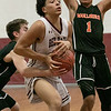 Fitchburg High School boys basketball played Marlborogh High School on Thursday night, Jan 30, 2020 in Fitchburg. MHS's #32 Jason Short reaches in to stop FHS's Monty Graham as he drives tot he basket. HElping his teammate is MHS's #1 Troy Gathers. SENTINEL & ENTERPRISE/JOHN LOVE