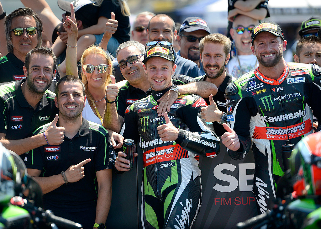 . The Kawasaki Team with riders Jonathan Rea (1) and Tom Sykes (66) celebrate after finishing first and second at the FIM Superbike World Championship at Mazda Raceway Laguna Seca on Sunday, July 9, 2017.  (Vern Fisher - Monterey Herald)