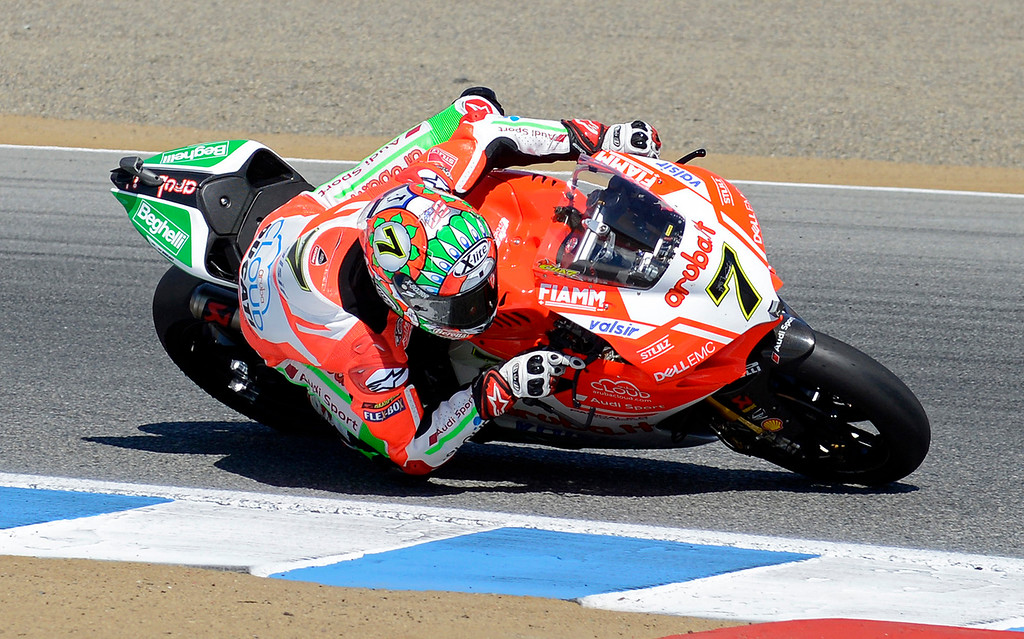 . Chaz Davies (7) from Great Britain leans his Ducati Panigale R through turn-3 at the FIM Superbike World Championship at Mazda Raceway Laguna Seca on Sunday, July 9, 2017.  (Vern Fisher - Monterey Herald)