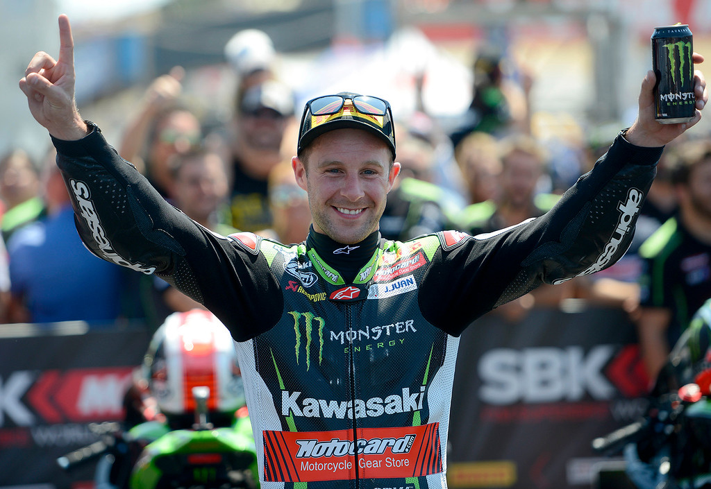 . Kawasaki Team rider Jonathan Rea (1) from Great Britain waves to the crowd in victory circle after winning the FIM Superbike World Championship at Mazda Raceway Laguna Seca on Sunday, July 9, 2017.  (Vern Fisher - Monterey Herald)