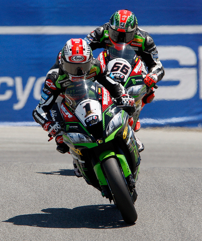 . Kawasaki Team rider Jonathan Rea (1) from Great Britain enters the corkscrew with teammate Tom Sykes (66) close behind as they enter the corkscrew during the FIM Superbike World Championship at Mazda Raceway Laguna Seca on Sunday, July 9, 2017.  Rea and Sykes would finish first and second.  (Vern Fisher - Monterey Herald)