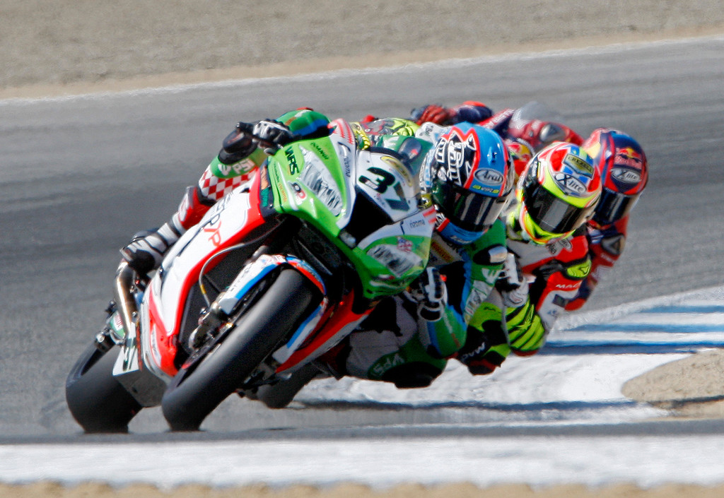 . Ondrej Jezek (37), Leandro Mercado (36) and Stefab Bradl (6) race through turn-2 together at the FIM Superbike World Championship at Mazda Raceway Laguna Seca on Sunday, July 9, 2017.  (Vern Fisher - Monterey Herald)