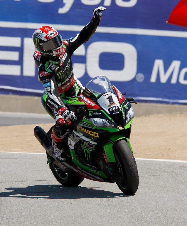 . Kawasaki Team rider Jonathan Rea (1) from Great Britain waves to the crowd at the corkscrew after winning the FIM Superbike World Championship at Mazda Raceway Laguna Seca on Sunday, July 9, 2017.  (Vern Fisher - Monterey Herald)