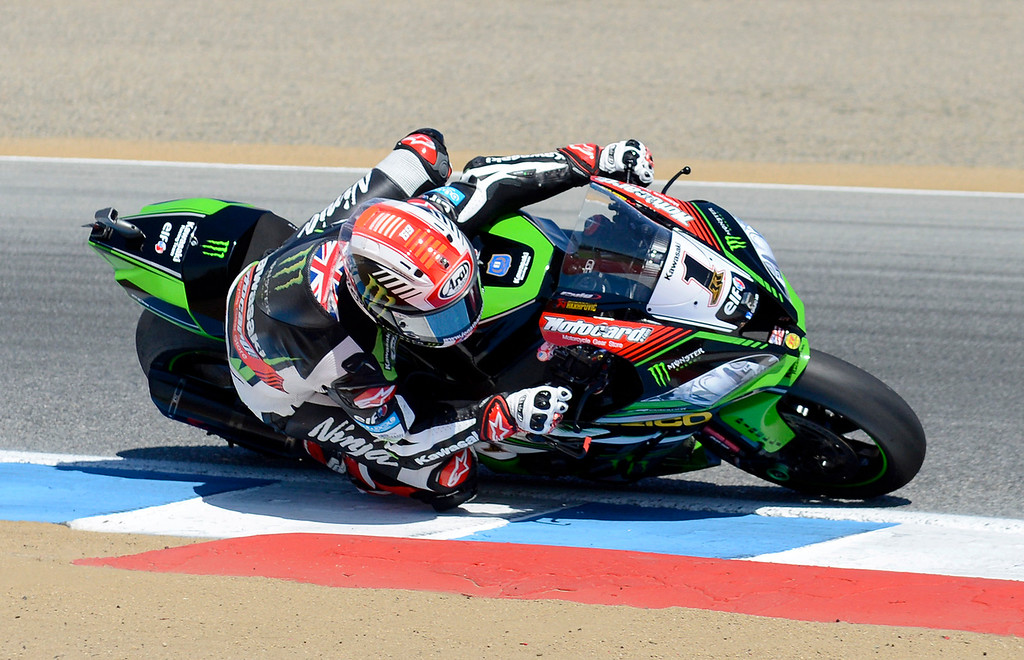 . Kawasaki Team rider Jonathan Rea (1) from Great Britain leans his Kawasaki ZX-RR through turn-3 on his way to winning the FIM Superbike World Championship at Mazda Raceway Laguna Seca on Sunday, July 9, 2017.  (Vern Fisher - Monterey Herald)