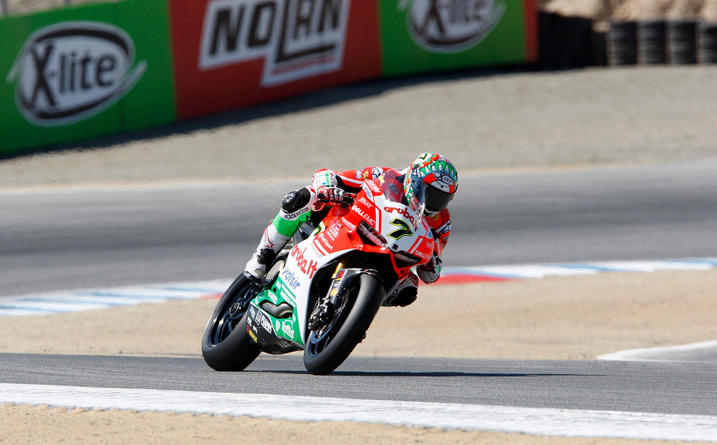 . Chaz Davies (7) from Great Britain leans his Ducati Panigale R through turn-2 at the FIM Superbike World Championship at Mazda Raceway Laguna Seca on Sunday, July 9, 2017.  (Vern Fisher - Monterey Herald)