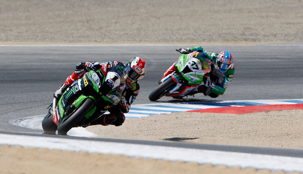 . Kawasaki Team rider Jonathan Rea (1) leads Ondrej Jezek (37) out of turn-2 at the FIM Superbike World Championship at Mazda Raceway Laguna Seca on Sunday, July 9, 2017.  (Vern Fisher - Monterey Herald)