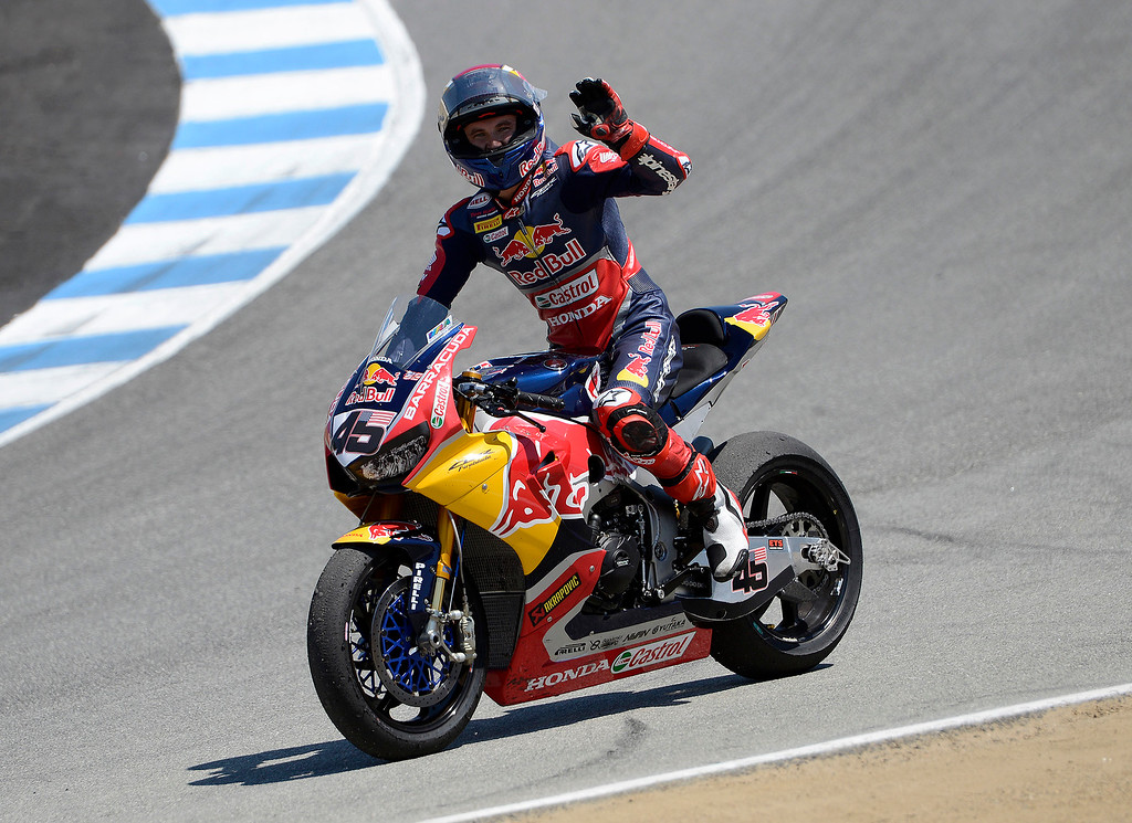 . Honda Red Bull Team rider Jake Gagne from USA waves to the crowd at the corkscrew after the FIM Superbike World Championship race at Mazda Raceway Laguna Seca on Sunday, July 9, 2017.  (Vern Fisher - Monterey Herald)