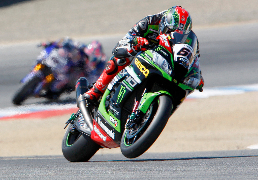 . Tom Sykes (66) from Great Britain gets his Kawasaki ZX-10RR on one wheel coming out of turn-2 during the FIM Superbike World Championship at Mazda Raceway Laguna Seca on Sunday, July 9, 2017.  (Vern Fisher - Monterey Herald)