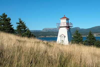 Woody Point Lighthouse at coast, Southeast Brook Falls, Gros Morne National Park, Newfoundland and Labrador, Canada