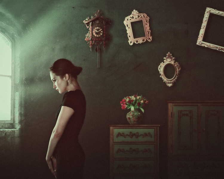Alone. Female portrait with home interior