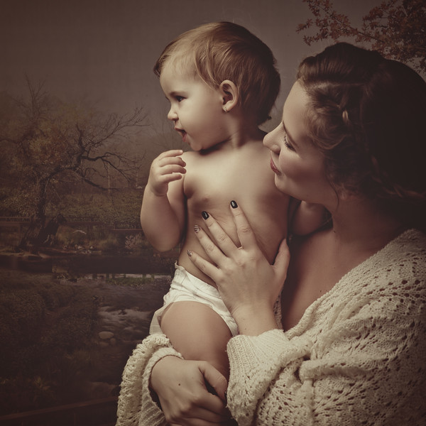 Contemporary Madonna, female portrait with little child, sepia toning