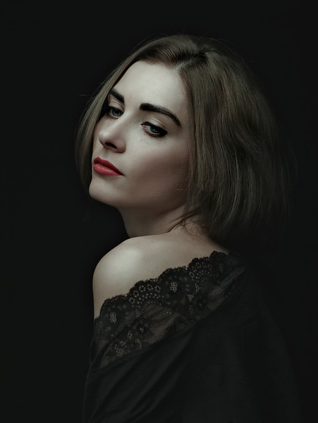 Dramatic female portrait against dark backgrounds