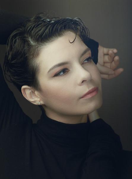 Beautiful brunette with short cut hair style. Classic studio female portrait