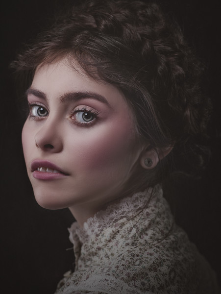 Retro styled beauty. Female portrait with art make up