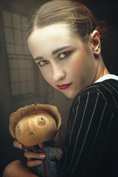 Young adult girl with his Puppet. Spooky female portrait with crazy doll