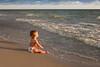 Baby at ocean's edge