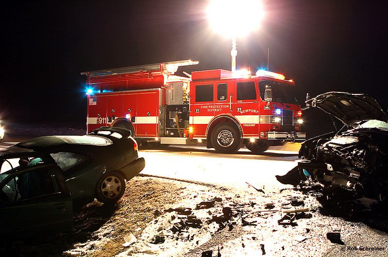 Newport Township fire engine 1458 lights the scene of an accident as Lake County Sheriff's dept investigates.
