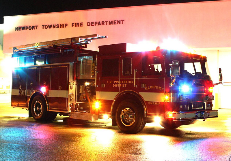 Newport Township fire engine / squad 1458 poses out in front of the station.