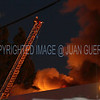 LAFD Chatsworth Industrial Fire : CHATSWORTH  - The cause of a fast-moving fire fueled by paper and other combustibles that destroyed a printing business in Chatsworth was pending results of an investigation that had not been disclosed as of this morning.      The blaze at Aaron Thomas & Associates in the 9200 block of Owensmouth Avenue was reported at 5:59 p.m. Wednesday and the fire was fully extinguished by 11 p.m., said Brian Humphrey of the Los Angeles Fire Department.     More than 200 firefighters responded, Humphrey said. No one was injured in the firefighting effort.     During the firefight, ``intense heat within the structure caused the catastrophic failure of a forklift mounted propane cylinder, propelling shrapnel through a section of rolling steel door that had yet to be opened,'' Humphrey said in a statement.     ``Though full roof failure occurred during an early phase of the firefight, the masonry walls remained intact as firefighters streamed massive volumes of water into the burning structure well into the night,'' Humphrey said. The fire was confined to the printing business. No injuries were reported.     The fire burned at the headquarters of Coronet Printing, a major political printer founded in 1946, according to its website.    Lenny Slatko, one of the company's principals, told CBS2 the plant had been running 24-hour, seven-day shifts because of Tuesday's election and had ``just wrapped things up, thank goodness.'' The plant had been open around the clock for at least the last six weeks, Slatko said.   A damage estimate has not been released.   Photos by Juan Guerra  -  LAFD Fire Photographer